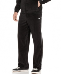 Kick back and greet the weekend in style with the ultimate comfort of these plush velour track pants from Puma.