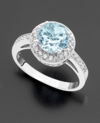 The icy dazzle of an round-cut aquamarine (1-3/8 ct. t.w.) is an ingenious complement to sparkling, full-cut diamonds (1/3 ct. t.w.). Set in 14k white gold.