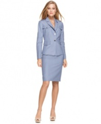 Calvin Klein's suit mingles a spring-ready linen blend with crisp design details, like buttoned shoulder epaulettes.