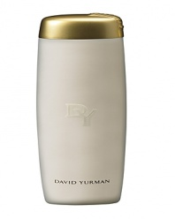 The luxuriously creamy David Yurman Bath and Shower Gel diffuses the rich notes of exotic woods and patchouli with the fluidity of peony and waterlily, leaving your skin delicately fragranced after each bath or shower.The Luxurious Bath and Shower Gel is packaged in a translucent white elongated bottle with a gold flip top cap, accented with the David Yurman signature cable motif.