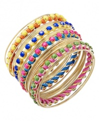 Leave not even an inch uncovered! Bar III's bohemian bracelet set features 29 separate bangles highlighting woven suede strands and bright acrylic beads in hues of pink, orange, blue green, and yellow. Crafted in gold-plated mixed metal. Approximate diameter: 3 inches.