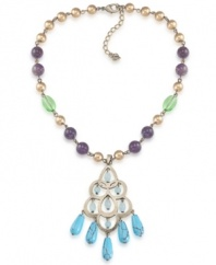 Pastel perfection. Carolee's elegant pendant features a beaded chain including amethyst (3-3/10 ct. t.w.) gold, and green glass beads and a turquoise-hued glass chandelier. Crafted in burnished gold-plated mixed metal. Approximate length: 16 inches + 2-inch extender. Approximate drop: 3-1/4 inches.
