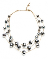 Eye-catching shimmer to spice up any office or weekend look. This Kenneth Cole New York necklace crafted from mixed metal features three strands of intricately faceted silver beads. Approximate Length: 16 inches with 2-inch extender.