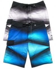 Get graphic. Whether you're hitting the beach or the streets, these Hurley board shorts turn the volume up on your sweet surfer style.