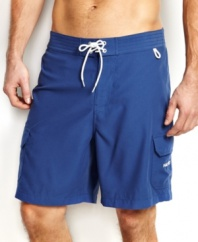 You'll be beach-ready with solid surf style with these swim shorts from Nautica.