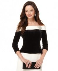 Alex Evenings' off-the-shoulder top is fashioned from a luxe velvet and outfitted with boning at the bodice for a defined fit. A brooch at the left shoulder finishes this pretty, festive look.