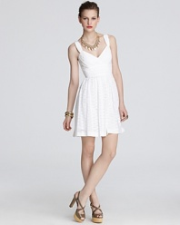 Fashioned in summer-perfect eyelet, this Shoshanna dress flaunts ladylike charm.