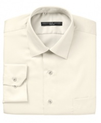 Crafted in convenient wrinkle wash fabric and expertly tailored for the modern man, this fitted Geoffrey Beene dress shirt jump-starts any guy's workweek wardrobe.