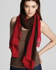 Go wild for this leopard printed scarf with a bright red contrast border.