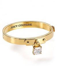 It's a lock. This simply-styled Juicy Couture bangle is a key addition to your arm party, cast in plated gold with a padlock charm.