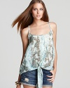 In a pale-hued snake print, this Aqua tank makes a chic entrance with a knotted front hem.